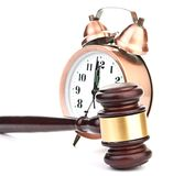 Gavel and old clock Royalty Free Stock Photography