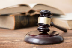 Gavel and open book. In background Royalty Free Stock Images