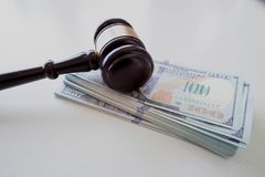 Gavel over money stock photography