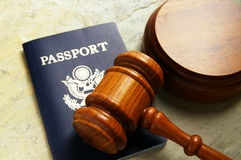 Gavel and passport. US passport and judges court gavel, from above Stock Photos