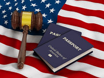 Gavel and passport on American flag Royalty Free Stock Photos