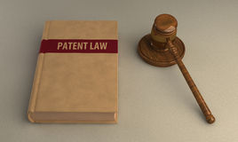 Gavel and patent law book. On linen surface. Conceptual illustration Royalty Free Stock Photography