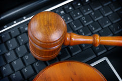 Gavel PC. Court gavel on laptop computer keyboard Royalty Free Stock Photography