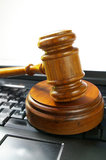 Gavel on pc Stock Photography