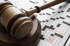 Gavel and puzzle. Crossword puzzle with legal terms, and judges court gavel Royalty Free Stock Photography