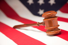 Gavel Resting on American Flag Stock Images