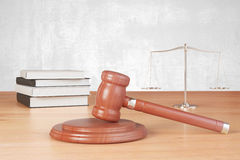 Gavel and scales on the wooden table Royalty Free Stock Images