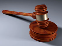 Gavel - a small ceremonial mallet. A hammer striking a gavel Royalty Free Stock Photo
