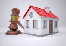 Gavel and small house. The gray background Royalty Free Stock Photos