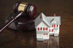 Gavel and Small Model House on Table Royalty Free Stock Images