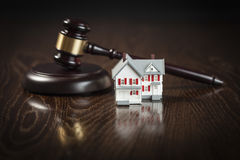 Gavel and Small Model House on Table Stock Photography