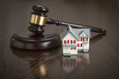 Gavel and Small Model House on Table Stock Images