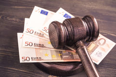 Gavel and some euro banknotes. Auction bidding, judicial system corruption concept.Toned Royalty Free Stock Photo