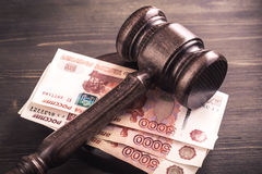 Gavel and some ruble banknotes. Auction bidding, judicial system corruption concept.Toned Royalty Free Stock Photo