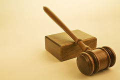 Gavel and Sound Block on Warm Plain Background Stock Images