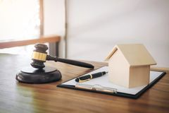 Gavel on sounding block at courtroom for decide home insurance,. Law and justice concept, Settle a house dealing lawsuit Stock Photos