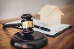Gavel on sounding block at courtroom for decide home insurance, Stock Image