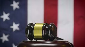 Judge`s Gavel Spins with American Flag, Looping Footage