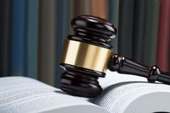 Gavel with stack of book Stock Image
