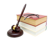 Gavel, a stack of books and glasses on white background Stock Image