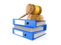 Gavel on stack of ring binders Stock Photo