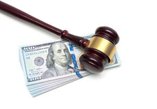 Gavel and stack of US dollars on a white background Royalty Free Stock Photography