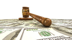 Gavel standing on a dollars Royalty Free Stock Photo