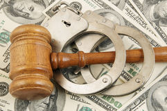 Gavel and handcuffs on money background Stock Photos