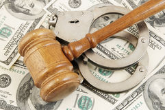 Gavel and handcuffs on money background Royalty Free Stock Image