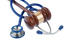 Gavel and stethoscope. Symbol photo for bungling doctors and error Royalty Free Stock Images