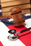 Gavel, Stethoscope and Books on Flag. Gavel, Stethoscope and Books on the American Flag with Selective Focus Royalty Free Stock Image