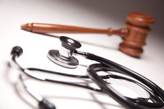 Gavel and Stethoscope on Gradated Background Royalty Free Stock Image