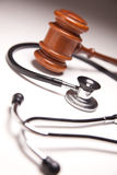 Gavel and Stethoscope on Gradated Background Stock Image
