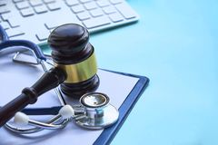 Gavel and stethoscope. medical jurisprudence. legal definition of medical malpractice. attorney. common errors doctors. Nurses and hospitals make stock images
