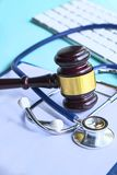 Gavel and stethoscope. medical jurisprudence. legal definition of medical malpractice. attorney. common errors doctors. Nurses and hospitals stock images