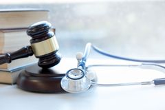 Gavel and stethoscope. medical jurisprudence. legal definition of medical malpractice. attorney. common errors doctors. Nurses and hospitals make royalty free stock image