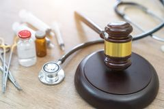 Gavel and stethoscope. medical jurisprudence. legal definition o. F medical malpractice. attorney. common errors doctors, nurses and hospitals make. 1 royalty free stock image