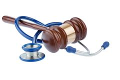 Gavel and stethoscope. Symbolic photo for bungling doctors and error royalty free stock photo