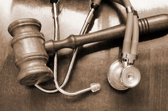 Gavel and stethoscope Stock Images