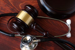 Gavel and stethoscope. On a wooden surface Royalty Free Stock Photos