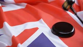 Gavel striking on sound block against british flag, parliament decision, justice