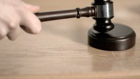 Gavel in super slow motion hitting a sound block Royalty Free Stock Image
