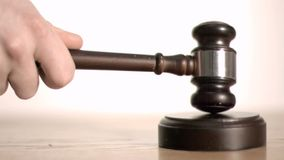Gavel in super slow motion striking a sound block Stock Image