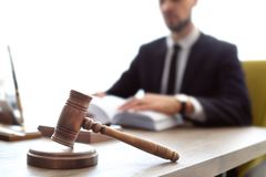 Gavel on table and lawyer. In office stock photo