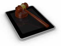 Gavel and tablet pc Stock Images