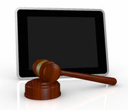 Gavel and tablet pc Royalty Free Stock Image