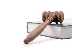 Gavel and Textbook. Wooden gavel and textbook.  Isolated on white Stock Images
