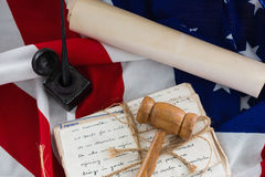 Gavel with tied up documents arranged on American flag Royalty Free Stock Photos