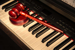 Gavel on top of piano keys Royalty Free Stock Photos