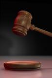 Gavel up. Judge's gavel up illuminated with red light on black background Royalty Free Stock Photography